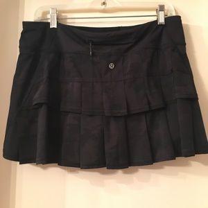 Black lululemon skirt with ruffled back.